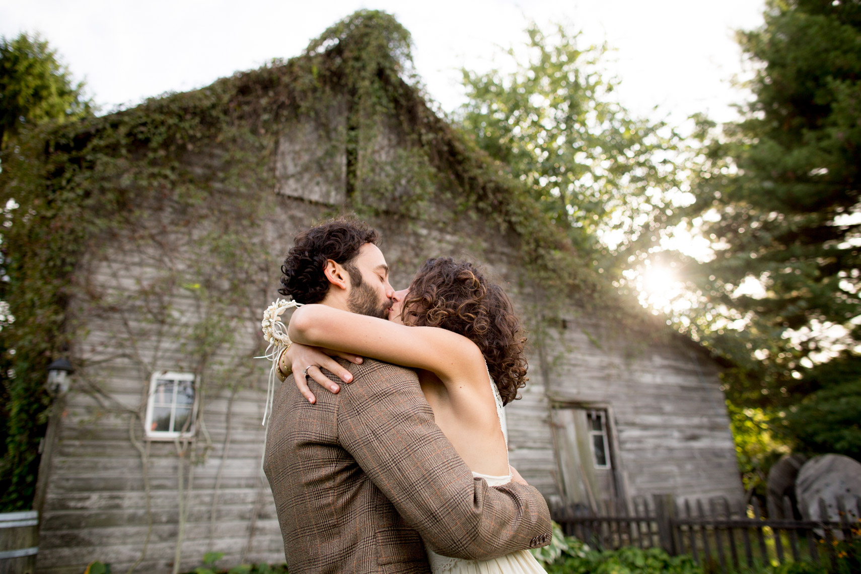 bride-groom-hugging-wedding-Liberty-View-Farm-sarma-and-co