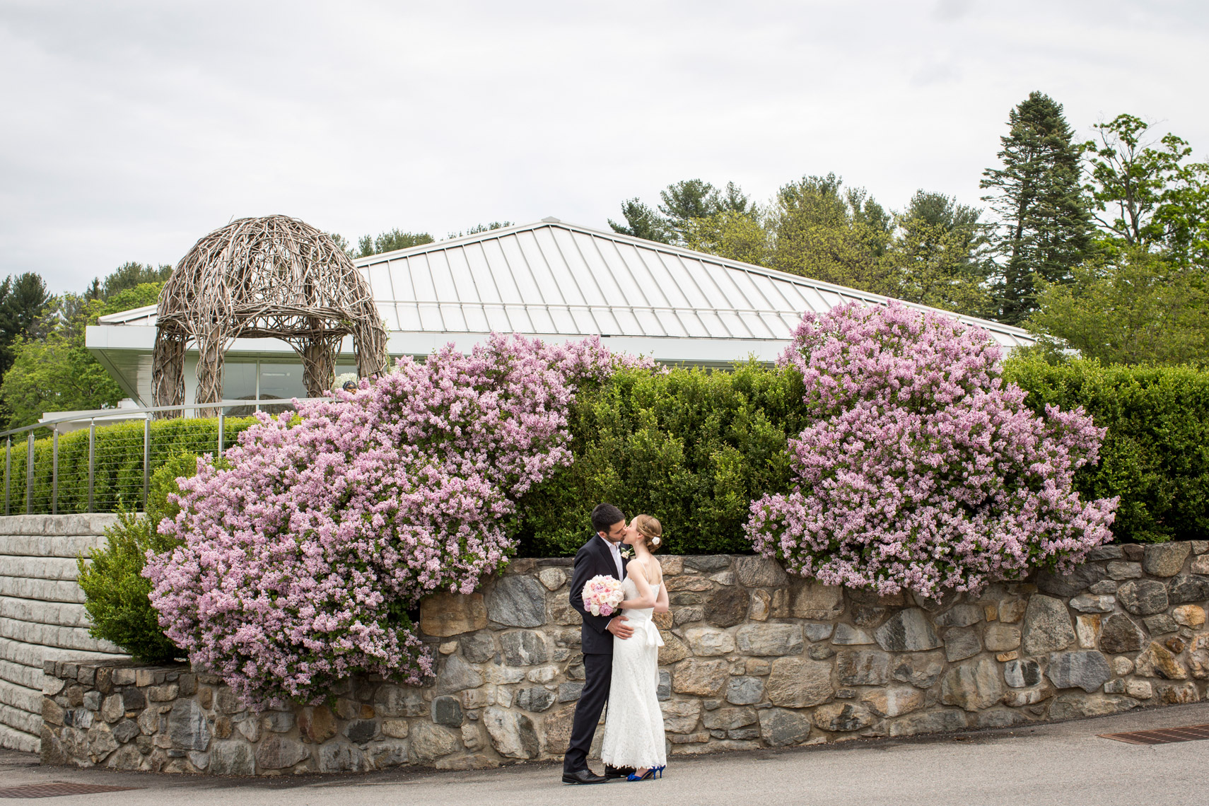 lilacs-bride-groom-kissing-The-Garrison-NY-sarma-and-co