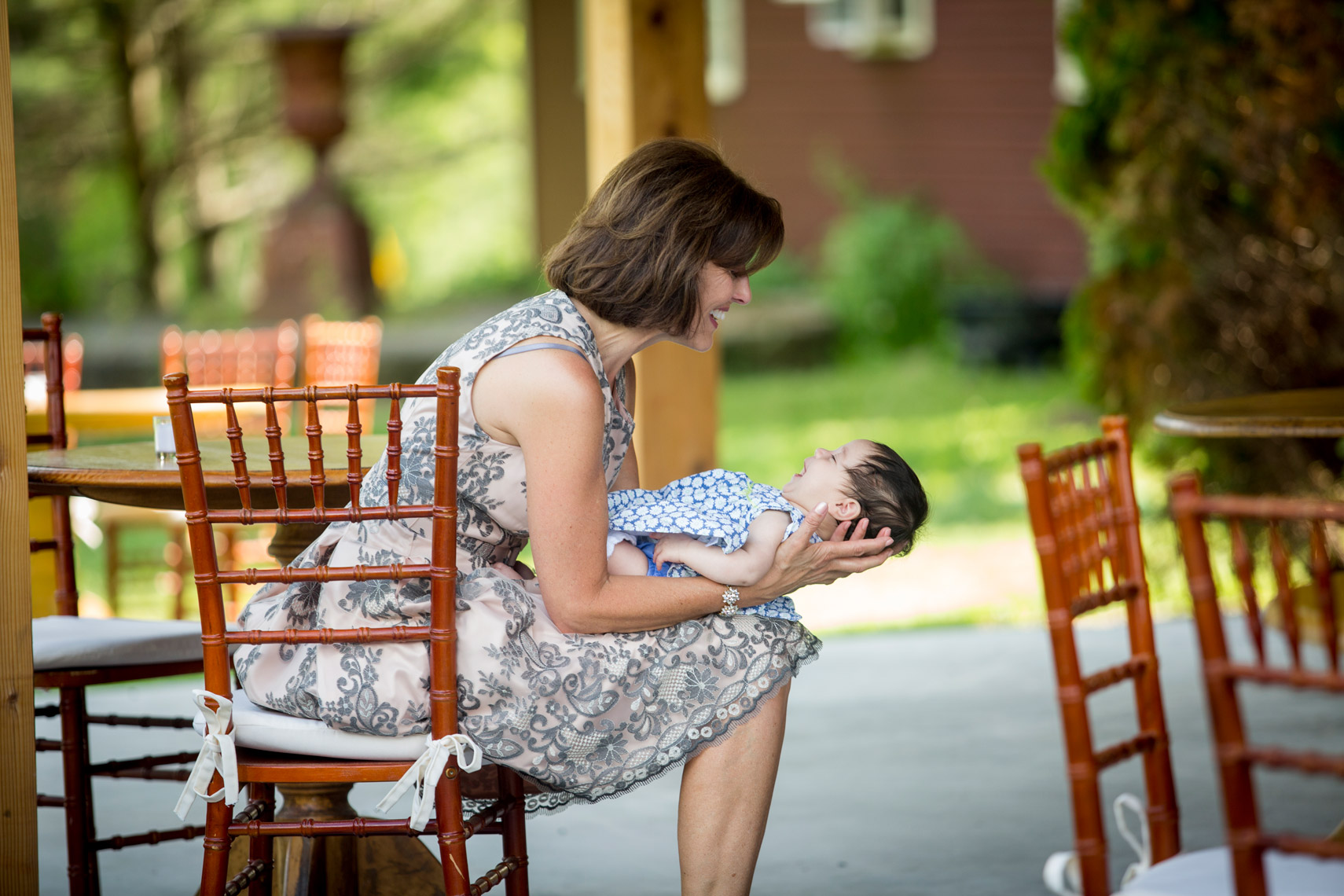 mother-of-the-bride-holding-a-baby-Gedney-Farm-wedding-photographer