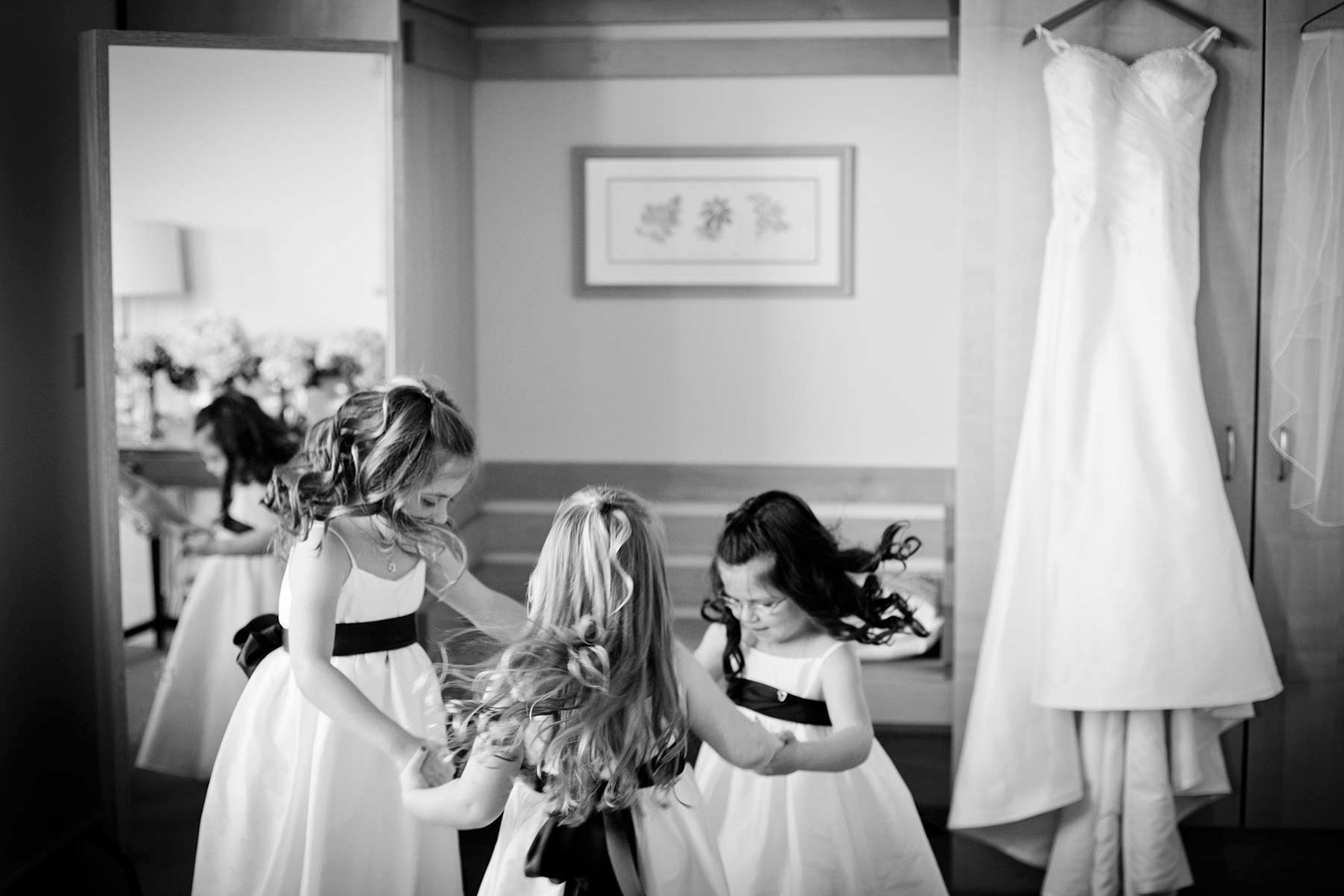 flower-girls-dancing-The-Garrison-wedding-photographers