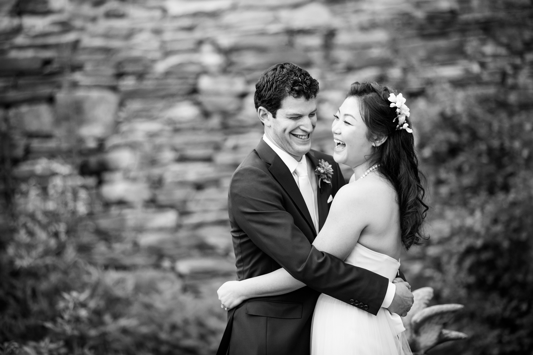 bride and groom laughing at Red Maple Vineyard